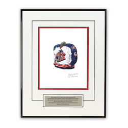 """Heritage Sports Art - Original art of the NHL 2003-04 Columbus Blue Jackets jersey - This beautifully framed piece features an original piece of watercolor artwork glass-framed in a timeless thin black metal frame with a double mat. The outer dimensions of the framed piece are approximately 13.5"""" wide x 17.5"""" high, although the exact size will vary according to the size of the original piece of art. At the core of the framed piece is the actual piece of original artwork as painted by the artist on textured 100% rag, water-marked watercolor paper. In many cases the original artwork has handwritten notes in pencil from the artist. Simply put, this is beautiful, one-of-a-kind artwork. The outer mat is a clean white, textured acid-free mat with an inset decorative black v-groove, while the inner mat is a complimentary colored acid-free mat reflecting one of the team's primary colors. The image of this framed piece shows the mat color that we use (Medium Blue). Beneath the artwork is a silver plate with black text describing the original artwork. The text for this piece will read: This original, one-of-a-kind watercolor painting of the 2003-04 Columbus Blue Jackets uniform is the original artwork that was used in the creation of thousands of Columbus Blue Jackets products that have been sold across North America. This original piece of art was painted by artist Nola McConnan for Maple Leaf Productions Ltd. The piece is framed with an extremely high quality framing glass. We have used this glass style for many years with excellent results. We package every piece very carefully in a double layer of bubble wrap and a rigid double-wall cardboard package to avoid breakage at any point during the shipping process, but if damage does occur, we will gladly repair, replace or refund. Please note that all of our products come with a 90 day 100% satisfaction guarantee. If you have any questions, at any time, about the actual artwork or about any of the artist's handwritten notes on"""