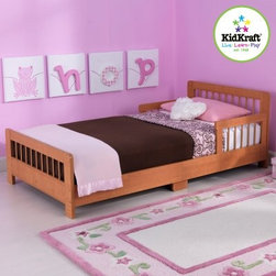 KidKraft Slatted Toddler Bed - Honey - Young boys and girls will feel all grown up when they go to sleep in the KidKraft Slatted Toddler Bed - Honey. This honey brown toddler bed helps make the transition from a crib to a regular bed as easy as possible with its low profile and protective bed rails. Constructed from sturdy solid wood this bed has added support in the center of the frame for extra durability. It fits most crib mattresses. Detailed assembly instructions are included. Dimensions: 51.57L x 28.27W x 18.15H inches.About KidKraftKidKraft is a leading creator manufacturer and distributor of children's furniture toy gift and room accessory items. KidKraft's headquarters in Dallas Texas serves as the nerve center for the company's design operations and distribution networks. With the company mission emphasizing quality design dependability and competitive pricing KidKraft has consistently experienced double-digit growth. It's a name parents can trust for high-quality safe innovative children's toys and furniture.