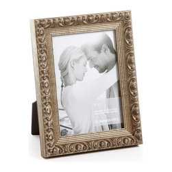 """Origin Crafts - Vintage silver wood picture frame - Vintage Silver Wood Picture Frame Amongst the twenty arrondissements or districts that make up Paris there is a former fortress which stands proud as the focal point of district number one ? the Louvre. A majestic masterpiece where priceless art is encased in classic elegance, founded in the spirit of authentic French tradition. It was here in the Louvre, inspired by its magnificence and contribution to modern culture that Vintage was born. Dimensions (in): Width: 1 1/4, Height: 1 Holds (4""""x6"""", 5""""x7"""", 8""""x10"""") photos. By Roma Moulding - Roma Moulding uses only the highest quality materials. Roma owes it?s renown to exquisite details: meticulous applications of gold and silver leafing, genuine woods, exotic veneers, patinas, superior lacquers and finishes all done by hand. Roma employs time proven techniques to achieve the stunning finishes other manufacturers strive to achieve. Ships within Five Business Days."""