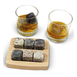 Sea Stone On the Rocks Drink Chillers Gift Set Square - A great gift idea, our On the Rocks Drink Chillers Gift Set Square will make every bar complete. Hand-crafted from natural stones collected from New England beaches. The Scottish have been chilling their whiskey with natural granite for hundreds of years. Functional, fashionable, and original, this set of granite drink chillers will cut down on the incidence of watered-down beverages due to melted ice. Especially designed for cocktail and nature enthusiasts alike, these stones will chill whiskies and other fine liquors to their ideal drinking temperature without adding unwanted taste and chemicals from frozen tap water, or diluting the drink. The set of six handcrafted chillers is presented in a FSC certified hardwood tray for freezing and serving, and because no two stones are alike, your glass is easy to identify when sipping with company. These are the perfect gift for all lovers of fine spirits. Boasting a classic look and an elegant feel, our Bambeco Classic Glasses are handmade from recycled clear glass. They're gently rounded at the base and have thicker shams for greater weight and stability. Set Includes: Drink Chiller Set of six square chillers and two 8 oz glasses.  Care: Dishwasher safe.