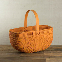 Woven Wooden Basket - A burst of orange modernizes an old-school woven wood basket. Add a little rustic, farmhouse appeal to a bathroom, for stashing extra hand towels, or even in the kitchen for fresh fruits and veggies.
