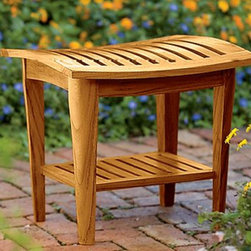 Teak shower stool teak bath stool - The finish on this stool reminds me of a tropical rainforest, the color is so rich. The teak wood is sustainably harvested and I like the different feel with the curved top. Use it to double as a side table.