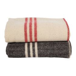 Coyuchi striped wool blankets - This classic wool throw adds a bit of old-school rustic chic to any space. Perfect for that cozy cabin or for bringing a bit of the cozy cabin home to the 'burbs! You know it's truly winter when you pull this baby out and throw it on top of your bed!