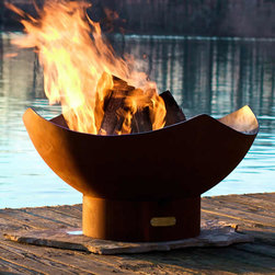 Manta Ray Fire Pit - The Manta Ray Fire Pit is made from one quarter inch ( 6.35 mm) thick steel. The sturdy construction assures you of having this functional art for many years to come. It has an iron oxide patina finish or high temperature paint on the outside. The iron oxide patina will darken a little with time then become permanent. The inside is coated with a high temperature resistant paint and has a rain drain in the bottom. And on top of all this, it is Made in the USA.