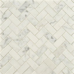 Statuary Stone Mosaic - Statuary is often misinterpreted for Calacatta or Carrara marble. It's got more gray than Calacatta and a whiter background that Carrara. Beautiful here as a mini-herringbone and would look great as a bathroom floor or behind a stove in a kitchen.