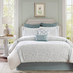 Harbor House - Harbor House Flourish 4 Piece Comforter Set - The Harbor House Flourish Comforter Set creates a calm and serene atmosphere with a soft blue and white color palette. The comforter features white and blue embroidered flowers that run down the center of the comforter leaving solid white space on the sides. Made from 100% cotton, this comforter is machine washable for easy care. Comforter & Sham Face: T180 100% cotton with embroidery Reverse: T180 100% cotton Filling: 300 gram/sqm polyester Bedskirt Drop: T180 100% cotton solid Platform: polyester/cotton