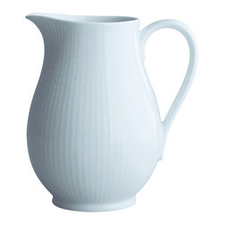 iittala Swedish Grace Pitcher 1.3Qt Snow - A design classic in six colours. This tableware still evokes the same emotions as when it was unveiled at the Stockholm Exhibition in 1930. Louise Adelborg succeeded in conveying the sensation of ears of wheat swaying in the summer breeze.
