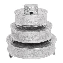 Aspire - Round Cake Stands - Set of 4 - These stands taper in size to provide stands for different sized cakes. The stands feature a decorative floral embossed pattern on the sides. Aluminum. Color/Finish: Silver. 5 in. H x 22 in. W x 22 in. D. 5 in. H x 18 in. W x 18 in. D. 5 in. H x 14 in. W x 14 in. D. 3 in. H x 6 in. W x 6 in. D. Weight: 14 lbs.