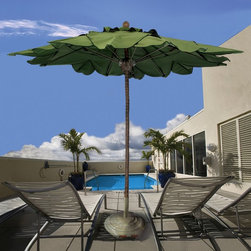 Fiberbuilt - Fiberbuilt 9-ft. Palm Tree Fiber Teak Market Umbrella Multicolor - 9PPP-4692 - Shop for Patio Umbrellas from Hayneedle.com! Additional features: Easy-to-use push up lift system with securing pin Flexible fiberglass ribs for strength and resilience Perfect for the poolside - just hose off to clean No assembly required Whether it's a cafe or your backyard the commercial-quality Fiberbuilt 9-ft. Palm Tree Market Umbrella is sure to grab attention with its unique look. The one-piece 1.5-inch-diameter aluminum pole is coated with textured fiberglass to simulate the look and feel of a real palm tree trunk. Complete with realistic ant holes in the faux tree trunk this umbrella also boasts a matching FiberTeak hub and finial adding to its uniquely authentic look. Flexible fiberglass ribs offer maximum strength and resilience even as the easy-to-use push up lift system with securing pin makes opening it a breeze. Made from fade- and stain-resistant palm green Sunbrella fabric this umbrella is virtually maintenance-free and perfect for lounging outdoors in cool comfort even on the hottest days. Designed for years of enjoyment this umbrella is just what you need to add a cool tropical look to your business or backyard. Please note: Use a minimum 45 lb. stand when using with a patio table; for free standing use pair with a minimum 75 lb. stand. About Sunbrella: Sunbrella has been the leader in performance fabrics for over 45 years. Impeccable quality sophisticated styling and best-in-class warranties prove the new generation of Sunbrella offers more possibilities than ever. Sunbrella fabrics are breathable and water-repellant. If kept dry they will not support the growth of mildew as natural fibers will. Sunbrella fabrics are so durable that stubborn stains can be cleaned with a bleach and water solution! We recommend visiting Sunrella.com they have the recommended solution based on the type of stain. Beautiful and durable Sunbrella is a name you can trust in your outdoor furniture. About Guy HarveyGuy Harvey is a unique blend of artist scientist diver angler conservationist and explorer fiercely devoted to his family and his love of the sea. A passion for the beauty and wonder of the underwater world has driven Dr. Guy Harvey to be a world renowned Marine wildlife artist and leading conservationist advocating for the protection of our environment. A portion of every purchase of a Guy Harvey product benefits the Guy Harvey Ocean Foundation which helps ensure that future generations will enjoy and benefit from a naturally balanced ocean ecosystem where fish and other marine wildlife flourish.