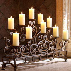 "Ambella - Small Fireplace Candelabrum - AmbellaSmall Fireplace CandelabrumDetailsEXCLUSIVELY OURS.Wrought-iron candelabrum.Small six-candle candelabrum 21.5""W x 7.5""D x 12.5""T.Imported.Designer About Ambella:Ambella Home Collection was founded by George Moussa in 1995 and is credited with being the first company to design and introduce the ""Sink Chest"" a traditional wooden chest with a sink mounted to the top and plumbed for a faucet fixture. Ambella carefully selects quality materials used for each handcrafted design then combines them with the best techniques and quality construction resulting in pieces that will last a lifetime. Ambella Home Collection continues to be an innovator in not only the sink chest category but furniture pieces for every room."