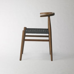John Vogel Chair | West Elm - Shaped and sculpted. This chair is the result of our collaboration with South African furniture designer John Vogel, known for his signature webbed seats. To translate his detailed process into the final product, we worked with artisans in China who hand-weave each seat.