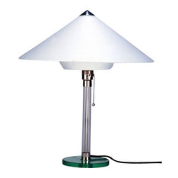"""Tecnolumen - Tecnolumen Wagenfeld WG 28 Table Lamp - The Wagenfeld WG 28 Table Lamp is designed by Wilhelm Wagenfeld and made by Tecnolumen. Wilhelm Wagenfeld created in the 1930s a series of table and floor lamps with synthetic shades which were based on his famous Bauhaus table lamps. Table lamp Tecnolumen Wagenfeld WG 28 stands out with its intricately designed lamp shade: the large cone-shaped shade is connected at the bottom to a conical element. It is made from heat-resistant plastic covered with white fabric.The WG 28 came, however, not by anyone, but a known quantity when it comes to the industrial-inspired combination of craftsmanship and inspired forms. So was Wagenfeld as a teacher or professor familiar with both the environment visual arts as well as senior positions in industrial design with expert glass and metal processing.         Product Details: The Wagenfeld WG 28 Table Lamp is designed by Wilhelm Wagenfeld and made by Tecnolumen. Wilhelm Wagenfeld created in the 1930s a series of table and floor lamps with synthetic shades which were based on his famous Bauhaus table lamps. Table lamp Tecnolumen Wagenfeld WG 28 stands out with its intricately designed lamp shade: the large cone-shaped shade is connected at the bottom to a conical element. It is made from heat-resistant plastic covered with white fabric.The WG 28 came, however, not by anyone, but a known quantity when it comes to the industrial-inspired combination of craftsmanship and inspired forms. So was Wagenfeld as a teacher or professor familiar with both the environment visual arts as well as senior positions in industrial design with expert glass and metal processing. Details:                         Manufacturer:            Tecnolumen                            Designer:            Wilhelm Wagenfeld                            Made in:            Germany                            Dimensions:            Base Diameter: 6.69""""  (17 cm) x Height:19.69"""" (50 cm) x Shade Diameter:17.32"""" (44 cm) """