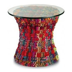 Ecofirstart 5 - Mandara Table by Currey & Co. _/_ A wire frame is covered in cotton fabric chindi ropes to create the Mandara table. Since the chindi is made from fabric remnants, each trunk is truly one of a kind. It's intriguing texture and repeated striped pattern are designed to warmly accent a space. The glass top can be removed and the base can be repurposed for seating.