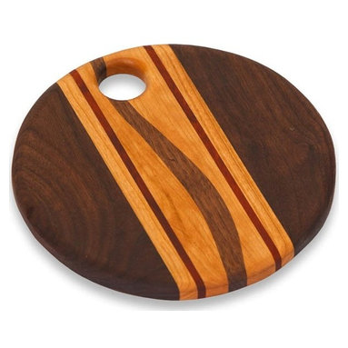 "Picnic Plus - Roda Cheese Cutting Board, Wood - Picnic Plus Roda Cheese Board, Cutting Board, Made In The USA, Wood. Color/Design: Wood; Beautifully handmade in the USA; Individually handmade by a skilled American craftsman; Designed and crafted from a variety of hardwoods such as Cherry, Maple, Walnut, Oak, Paduak, Ash and Purpleheart; Due to the construction and design of each board and the natural wood grain no two boards will be exactly alike; Support our local craftsman with your purchase of this hand crafted board; Hand wash only. Dimensions: 9 1/4""D x 1""H"