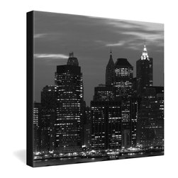 DENY Designs - Leonidas Oxby New York Financial District Gallery Wrapped Canvas - Nighttime city lights set off the imposing silhouette of New York City's financial district in this image of cosmopolitan sophistication. Leonidas Oxby's black and white photo is dye-printed onto a frameless canvas for a contemporary presentation.
