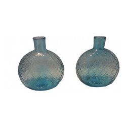 Blue Glass Bottles - Pair of turn of the century glass bottles, great for flower or decorative accent.  They appear to mold made, pattern is on both sides of the bottles as well.