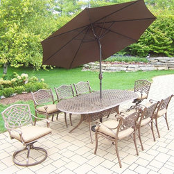 Oakland Living - 11-Pc Oval Patio Dining Set - Includes table and six dining chairs, two swivel chairs, 9 ft. tilt crank umbrella with stand and metal hardware. Handcast. Umbrella hole table top. Fade, chip and crack resistant. Traditional lattice pattern and scroll work. Hardened powder coat. Rust free. Warranty: One year limited. Made from cast aluminum. Antique bronze finish. Minimal assembly required. Table: 84 in. L x 42 in. W x 29 in. H (99 lbs.). Chair: 21.5 in. W x 23 in. D x 34 in. H (27 lbs.)The Oakland Mississippi Collection combines southern style and modern designs giving you a rich addition to any outdoor setting. This dining set is the prefect piece for any outdoor dinner setting. Just the right size for any backyard or patio.