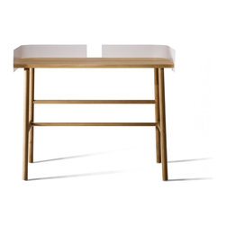 Industry West - Universo Writing Desk - Modern simplicity. This contemporary writing desk is made from solid oak and powder-coated metal for a dynamic mix of materials. Created by husband and wife design duo,Lara & Jan, its sleek, compact size is perfect for small work spaces.