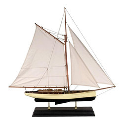 Authentic Models - Large 1930s Classic Model Yacht - Clean and crisp sails, bronze portholes and lots of nice details. Made of Wood, Cotton, and Brass. Dark Green, Ivory, and Gold Finish. Assembly Instructions. 35.4 in. W x 5.9 in. D x 35.4 in. HA sailor's dream, attractive and well proportioned a beauty. This classic 1930s yacht model sits on a beautifully molded antique finished stand, supported by two brass feet.
