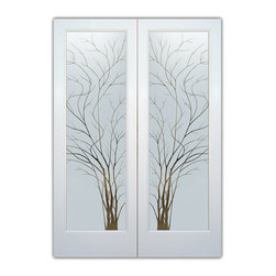 """Interior Glass Doors - Frosted Semi Private WISPY TREE PAIR - CUSTOMIZE YOUR INTERIOR GLASS DOOR!  Interior glass doors ship for just $99 to most states, $159 to some East coast regions, custom packed and fully insured with a 1-4 day transit time.  Available any size, as interior door glass insert only or pre-installed in an interior door frame, with 8 wood types available.  ETA will vary 3-8 weeks depending on glass & door type.........Block the view, but brighten the look with a beautiful interior glass door featuring a custom frosted glass design by Sans Soucie!   Select from dozens of sandblast etched obscure glass designs!  Sans Soucie creates their interior glass door designs thru sandblasting the glass in different ways which create not only different levels of privacy, but different levels in price.  Bathroom doors, laundry room doors and glass pantry doors with frosted glass designs by Sans Soucie become the conversation piece of any room.   Choose from the highest quality and largest selection of frosted decorative glass interior doors available anywhere!   The """"same design, done different"""" - with no limit to design, there's something for every decor, regardless of style.  Inside our fun, easy to use online Glass and Door Designer at sanssoucie.com, you'll get instant pricing on everything as YOU customize your door and the glass, just the way YOU want it, to compliment and coordinate with your decor.   When you're all finished designing, you can place your order right there online!  Glass and doors ship worldwide, custom packed in-house, fully insured via UPS Freight.   Glass is sandblast frosted or etched and bathroom door designs are available in 3 effects:   Solid frost, 2D surface etched or 3D carved. Visit our site to learn more!"""