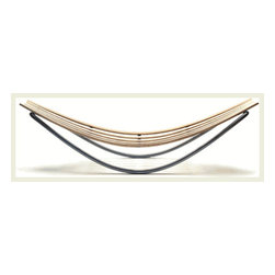 SMILE BY DAVID TRUBRIDGE - I have to say that this is probably one of the favorite loungers I have ever seen. I love the rocking steel frame with the natural bent wood creating a cradle. It's sleek and stylish but natural at the same time.