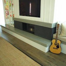 Modern Indoor Fireplaces by Mark Concrete