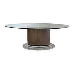 Used Mid-century Oval Dining Table - Mid-century dining table supported on a brass-tone ribbed laminate oval bass with stepped Lucite. Brass-tone laminate top, covered by oval glass with a beveled ogee edge. In good vintage condition with some scratching on the glass.