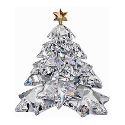 Swarovski - Swarovski Christmas Tree Shining Star - Swarovski Crystal Christmas Tree Shining Star  -  Size: 3.75 inches wide x 4.25 inches tall  -  Sophisticated and contemporary, this clear crystal tree adds festive magic to any space. It is made up of layers of star-shaped branches, resulting in an exceptional brilliance. An ideal decoration or gift, you can be sure that this tree will never lose its sparkle.  -  Fine Silver Crystal  -  Made In Austria