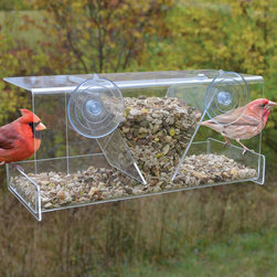 Songbird Essentials - Clear View Deluxe Hopper Window Feeder - Up close and personal bird watching. Great for introducing children to birding. Easy-to-fill hopper holds 4 cups of seed. Covered roof provides all-weather feeding. Constructed of heavy, clear acrylic. 2 large suction cups attach securely to window.
