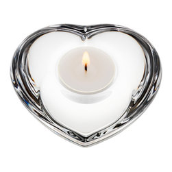 Orrefors - Amour Votive - The human heart holds many mysteries, but there's no mystery in the inspiration or the name for this lovely votive: brilliant cool crystal made soft and warm by its form. A perennial Orrefors favorite to collect and give.