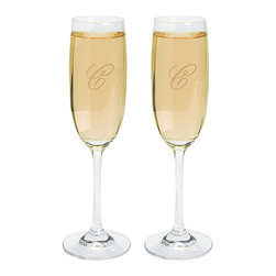 Personalized Monogrammed Champagne Flutes - Have a set of glasses engraved with the new homeowners' move-in date and combine them with a bottle of bubbly.