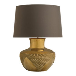 "Arteriors - Arteriors - Oromaya Table Lamp - DK17018-205 - Arteriors matches a fresh approach to design with handmade artistry and top-notch craftsmanship. The Oromaya lamp delivers the modern living room eye-catching style made distinct by golden allure. Marrying rich texture with smooth surfaces, the solid wood base exudes a glamorous luster in an antiqued brass finish. The light fixture's beige linen shade lends a gorgeous complement with soft hand-rolled edges. Table lamp accepts 150W max bulb (not included). Features: Oromaya Collection Table LampRound ShapeLamp delivers the modern living room eye-catching style made distinct by golden allureMarrying rich texture with smooth surfacesThe solid wood base exudes a glamorous lusterAntiqued brass finishLinen shade lends a gorgeous complement with soft hand-rolled edgesTable lamp accepts 150W max bulb Some Assembly Required.Dimensions: 19"" Diameter x 25.5""HCord: 8'L"