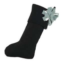 Chooty & Co. - Chooty and Co Circa Solid Night Christmas Stocking Multicolor - TT191030B - Shop for Holiday Ornaments and Decor from Hayneedle.com! While the tradition is classic your Chooty and Co Circa Solid Night Christmas Stocking is anything but. This updated Christmas stocking is made of a linen and rayon blend fabric in bold black. Its sage green and winter white fabric flower adds festive detail. This stocking is generously sized and durable enough to be stuffed full of gifts. It should be hand- or spot-cleaned to ensure long lasting beauty.About Chooty & Co.A lifelong dream of running a textile manufacturing business came to life in 2009 for Connie Garrett of Chooty & Co. This achievement was kicked off in September of '09 with the purchase of Blanket Barons well known for their imported soft as mink baby blankets and equally alluring adult coverlets. Chooty's busy manufacturing facility located in Council Bluffs Iowa utilizes a talented team to offer the blankets in many new fashion-forward patterns and solids. They've also added hundreds of Made in the USA textile products including accent pillows table linens shower curtains duvet sets window curtains and pet beds. Chooty & Co. operates on one simple principle: What is best for our customer is also best for our company.