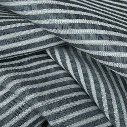Striscia Sheer Stripe Drapery Fabric in Denim Blue - Striscia Sheer Stripe Drapery Fabric in Denim Blue is a grey-blue drapery fabric with a small scale stripe pattern. Ideal for window treatments or canopies, this contemporary fabric has a great quality and price! Made from a blend of 80% linen and 20% cotton. Passes 3,000 double rubs. Cleaning code: S. Width: 59″