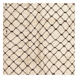 Consigned Vintage Moroccan Rug - Moroccan Rug, Morocco, Mid 20th Century - The expansive linear decorations, the crisp achromatic colors and the superb textures featured in this vintage Moroccan rug typify the mid-century era. This chic Moroccan rug depicts a refined latticework pattern with bold rectilinear intersections that are set over a warm ivory field. This grand allover latticework pattern is flanked by decorative end pieces that feature intense decorations and small-scale latticework figures that continue the stark color palette and minimalist theme. Created in an expressive, improvisational manner, this timeless mid-century Moroccan rug celebrates the freedom of design and creativity. The irregular nature of the variable geometric motifs and the meandering linear figures give this vintage Moroccan rug an iconic sense of modernity.