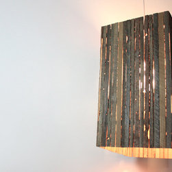 Rustic Pendant Light Fixture by Made for Each Other - Cleverly designed to use the scraps from their reclaimed wood furniture, the pendant lamp by Made for Each Other is not only ecofriendly, but warm and rustic as well.