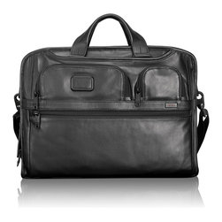 """Tumi - Alpha 2 Black Leather Compact Large Screen Laptop Brief - TumiAlpha 2 Black Leather Compact Large Screen Laptop BriefDetailsMade of leather.External front U-zip pockets waterproof pocket Back zip and open pockets zip opening to main compartment Add-a-Bag sleeve and removable/adjustable shoulder strap.Internal padded computer compartment Tumi ID Lock zip pocket tablet pocket open pocket card pockets pen loops and key leash.17.5""""W x 3.5""""D x 13.5""""T; laptop compartment holds up to a 17"""" laptop 16""""W x 1.75""""D x 11.5""""T.Imported.Designer About Tumi:Started in 1975 and now a leading international brand of travel business and lifestyle accessories Tumi is dedicated to providing customers with an outstanding ownership experience. During the 1980s Tumi introduced soft ultra-functional black-on-black ballistic nylon travel bags. Today Tumi holds more than 25 patents for its design and engineering breakthroughs."""