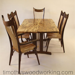 """""""The Madison"""" Dining Table and Chairs - This """"Urban-Organic"""" live edge dining set will fit beautifully into any of several contemporary decorative styles: mid-century modern (think: """"studio furniture movement"""") Cowboy-Western, lodge-style, urban loft, Asian or Craftsman style. This versatile table is  42 x 72 inches with an elegant trestle base. Two of the six chairs have arms and the rest do not. All chairs are hand-carved with very comfortable seats, and curved back stays to provide lumbar support."""