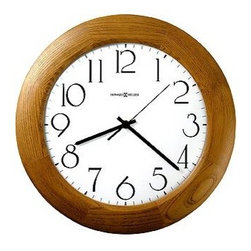 "Howard Miller - Santa Fe Champagne Oak Stained Round Wall Clo - Although this wall clock may seem simple, it features an elegant overall design. The frame is finished in a warm champagne oak finish. The Arabic numerals are finished in black and are set against a white background. This clock features a design that is easy to accessorize, but is still stylish. * Wood bezel and a crisp white dialBlack Arabic numerals and hands are covered by a convex glass crystalChampagne Oak finish on select hardwoods and veneersQuartz, battery operated movement1 1/2"" D12 3/4 Diameter"