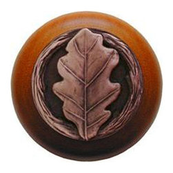 "Notting Hill - Notting Hill Oak Leaf/Cherry Wood Knob - Antique Copper - Notting Hill Decorative Hardware creates distinctive, high-end decorative cabinet hardware. Our cabinet knobs and handles are hand-cast of solid fine pewter and bronze with a variety of finishes. Notting Hill's decorative kitchen hardware features classic designs with exceptional detail and craftsmanship. Our collections offer decorative knobs, pulls, bin pulls, hinge plates, cabinet backplates, and appliance pulls. Dimensions: 1-1/2"" diameter"