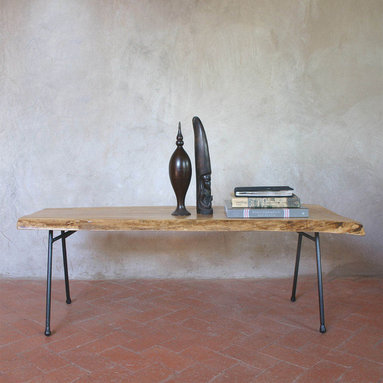 Pfeifer Studio Collection - This bench is created from a slab of eco-harvested Elm wood with a live edge and handmade steel base with a blackened finish. Chinese Elm Trees were first planted in Albuquerque, New Mexico in the early 20th Century. They eventually spread into the bosque (woodlands along the Rio Grande River) where they are pushing out native species, such as Cottonwoods, altering this delicate eco-system. Elms are now being removed in an effort to help restore the bosque and we are snatching them up to make these elegant, contemporary bench tables.