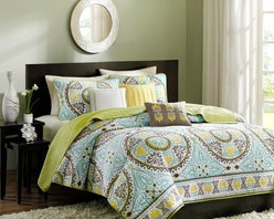 Madison Park Samara Bali 6 Piece Quilted Coverlet Set - The Madison Park Samara Bali 6 Piece Quilted Coverlet Set adds a fun pop of color and style to your dorm or bedroom. Bright yellows blues and greens work together to create an intricate boho medallion design. Made of plush cotton and polyester this bedding is ultra comfy and machine-washable. Offered in a variety of sizes. It includes the quilted coverlet two pillow shams and three decorative pillows. Coverlet Dimensions: Full/Queen: 90 x 90 in. King: 104 x 94 in.