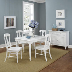 Home Styles - Home Styles Bermuda Brushed White 5 Piece Dining Set - 5543-318 - Shop for Dining Sets from Hayneedle.com! Friends and family will love gathering around your Home Styles Bermuda Brushed White 5 Piece Dining Set. The best of British colonial and old world tropical styles this set includes a generous dining table with leaf and four chairs. It's well-crafted of mahogany solids and engineered wood in a designer brushstroke white finish. Details include turned and tapered legs fiddle back chair designs and an 18-inch removable leaf.About Home StylesHome Styles is a manufacturer and distributor of RTA (ready to assemble) furniture perfectly suited to today's lifestyles. Blending attractive design with modern functionality their furniture collections span many styles from timeless traditional to cutting-edge contemporary. The great difference between Home Styles and many other RTA furniture manufacturers is that Home Styles pieces feature hardwood construction and quality hardware that stand up to years of use. When shopping for convenient durable items for the home look to Home Styles. You'll appreciate the value.