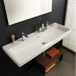 Tecla - Rectangular White Ceramic Wall Mounted, Vessel, or Built-In Sink - Modern style rectangular white ceramic sink with overflow. Luxurious bathroom sink can be wall mounted, above counter, or vanity. Available with no hole, one hole, two hole, or three holes. Made in Italy by Tecla. Rectangular white ceramic sink. ADA compliant. Wall mounted, vessel, or built-in. With overflow. No hole, one hole, two hole, or three holes. Spread for the Two Hole Option is 22 inches. From the Tecla Cangas Collection. Standard drain size of 1.25 inches. Because the sink has multiple installations, the back side is not glazed.