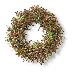 Frontgate - Mini Eucalyptus Wreath - Crafted of lifelike faux berries and mini eucalyptus. Hang indoors or in a covered outdoor area. Adds instant color to your entry. Embellish with a ribbon for a special occasion. Symbolic of wealth and abundance, our Mini Eucalyptus Wreath celebrates the beauty of the harvest with exceptional realism. Crafted from mini eucalyptus with berry accents, this lifelike wreath can be used indoors or in a protected outdoor area.  .  .  .  .