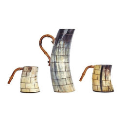 "Pre-owned Horn & Bamboo Pitcher and Mug Set - English horn pitcher and 2 mugs with bamboo handles from the 70's. These pieces are finished in a scored brick pattern. Extremely unique display pieces that will add texture, color, and an organic vibe to any space in need.    Dimensions:  Pitcher: 9""H X 3.5""D, with handle: 5.5""D    Mug: 4""H X 3""D, with handle: 5""D"