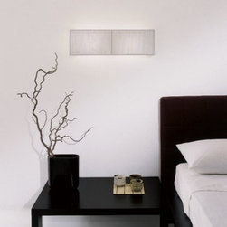 """Clavius PL wall sconce - The Clavius collection consists of lamps with chrome plated frames and handmade silk thread lampshades. They are available in ivory white, black and tobacco. The lamp shade has an opal acrylic diffuser. The series includes table, ceiling, wall and floor lamps as well as pendant lights.  Clavius P wall sconce: It features a chrome plated frame and a silk thread lampshade. Available with incandescent or fluorescent lamping.  Product description: The Clavius PL wall sconce from the Axo collection consists of lamps with chrome plated frames and handmade silk thread lampshades. They are available in ivory white, black and tobacco. The lamp shade has an opal acrylic diffuser. The series includes table, ceiling, wall and floor lamps as well as pendant lights.  Clavius P wall sconce: It features a chrome plated frame and a silk thread lampshade. Available with incandescent or fluorescent lamping.  Details:                         Manufacturer:                         Axo Light                                         Designer:                         Manuel Vivian                                         Made in:            Imported from Italy                            Dimensions:                         Height: 7.1"""" (18cm) x width: 23.6"""" (60 cm) x ext.: 4.7"""" (12 cm)                                         Light bulb:                         2 x 60W - incandescent light bulbs (not included) or              1 x 36W - T5 fluorescent light bulbs (not included)                                         Material             silk, chrome plated metal            Designer Manuel Vivian:  Born in Venice in 1971, his interest in design started when he was very young, in particular with reference to blown glass, also thanks to his family business. After succeeding in making the first projects in glass, Manuel enlarged his range of interests to the various fields of Interior Design. Since AXO Light was born in 1997, he has been cooperating constantly with the comp"""