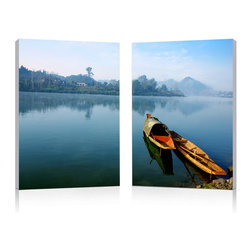 """Wholesale Interiors - Traditional Travel Mounted Photography Print Diptych - Two traditional East Asian vessels rest calmly along the shore on still, sparkling waters. This compelling, vivid photograph is a diptych: it has been split for display on two separate MDF frames that are meant to be displayed in close proximity to one another. The image is printed on two pieces of durable waterproof vinyl before being mounted to the frames, which are easy to clean: wipe with a dry cloth to maintain their original beauty. This modern photography wall art set is made in China, comes fully assembled and ready to hang, and does not include mounting hardware. Product dimension: 15.75""""W x 1""""D x 23.62""""H."""