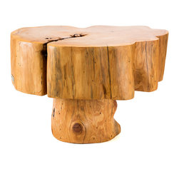 Patron Design - Patagonian Salvaged Cypress Side Table - Don't cry for me, Argentina — or for the tree that made this side table, for that matter. It's sculpted from a salvaged cypress tree that once grew in Patagonia. Each one is unique and comes with a plaque indicating age and origin of the tree. It'll add a funky, natural element to your favorite space.