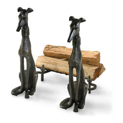 Dog Andirons - Set of 2 - A traditional accessory to the upscale hearth, the necessities of the fireside have long been given personality to express the homeowner's tastes. The Dog Andirons, a set of elegantly upright hounds crafted in bronze-finished metal, embody this classic inclusion in one of the most convivial of spaces. Add a flash of aristocratic interest with this well-made pair.